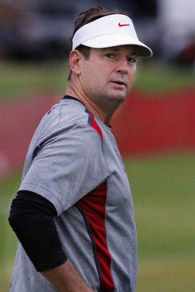 Photo - Head coach Bob Stoops looks over his shoulder during the University of Oklahoma (OU) Sooners first day of practice on Thursday, August 4, 2011, in Norman, Okla.   Photo by Steve Sisney, The Oklahoman