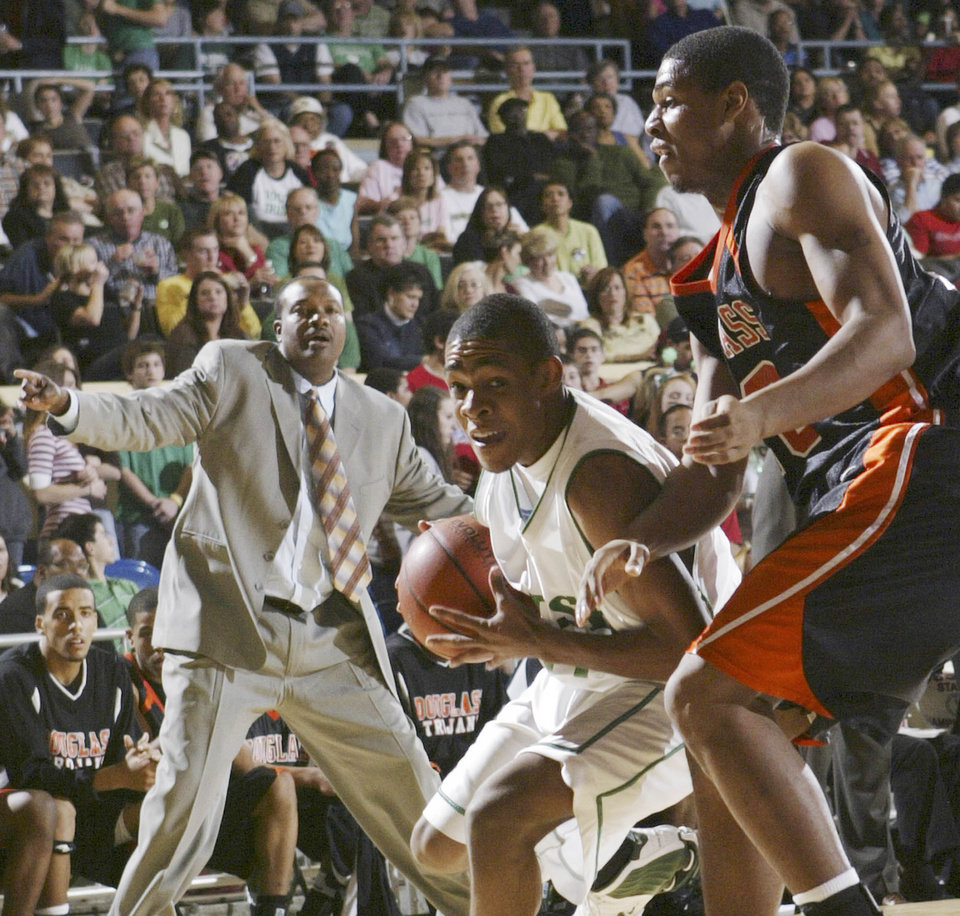 Photo - STATE TOURNAMENT: Douglass coach Terry Long, left, watches from the bench as Bishop McGuinness' Alex Moorehead drives on Douglass' Anton Gibson, right, in the first half, during the Class 4A Boys Oklahoma High School Basketball Championship game, at the State Fair Arena in Oklahoma City, Saturday, March 11, 2006.  By Chris Landsberger, The Oklahoman.