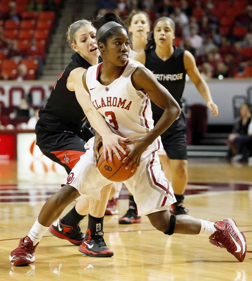 Photo - Cal State Northridge's Randi Friess (22) pressures Oklahoma's Aaryn Ellenberg (3) in the first half during a women's college basketball game between the University of Oklahoma (OU) and Cal State Northridge at the Lloyd Noble Center in Norman, Okla., Saturday, Dec. 29, 2012. Photo by Nate Billings, The Oklahoman