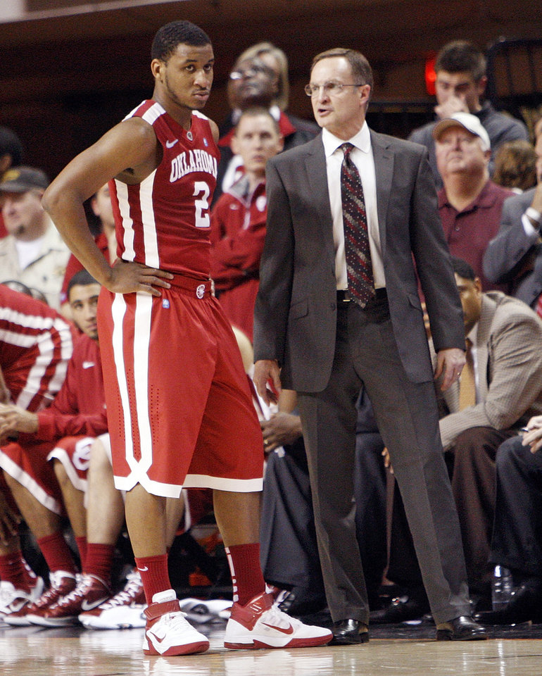 Photo - OU head coach Lon Kruger talks with Steven Pledger (2) after he fouled out in the second second half of the Bedlam men's college basketball game between the Oklahoma State University Cowboys and the University of Oklahoma Sooners at Gallagher-Iba Arena in Stillwater, Okla., Monday, Jan. 9, 2012. OSU beat OU, 72-65. Photo by Nate Billings, The Oklahoman