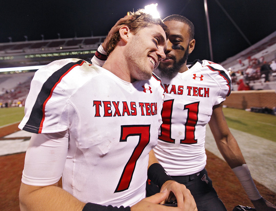 Photo - Texas Tech's Seth Doege (7) and Tramain Swindall (11) celebrate the 41-38 win over Oklahoma as they leave the field after the college football game between the University of Oklahoma Sooners (OU) and Texas Tech University Red Raiders (TTU) at the Gaylord Family-Oklahoma Memorial Stadium on Sunday, Oct. 23, 2011. in Norman, Okla. Photo by Chris Landsberger, The Oklahoman