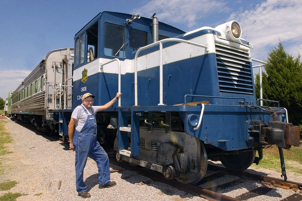 Photo - Jim Murray stands next to a 1941 General Electric locomotive at the Oklahoma Railway Museum, 3400 NE Grand Boulevard. This locomotive will pull a dining car and caboose to give rides to visitors to the museum. Staff photo by Nate Billings. Murray died of a stroke Friday, May 3. His funeral will be open to the public and at the museum Tuesday, May 14  NATE BILLINGS - THE OKLAHOMAN