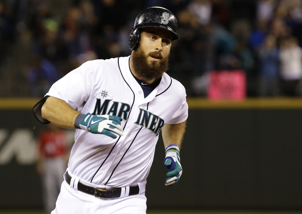Photo - Seattle Mariners' Dustin Ackley rounds the bases after he hit a solo home run against the Washington Nationals in the eighth inning of a baseball game, Saturday, Aug. 30, 2014, in Seattle. (AP Photo/Ted S. Warren)