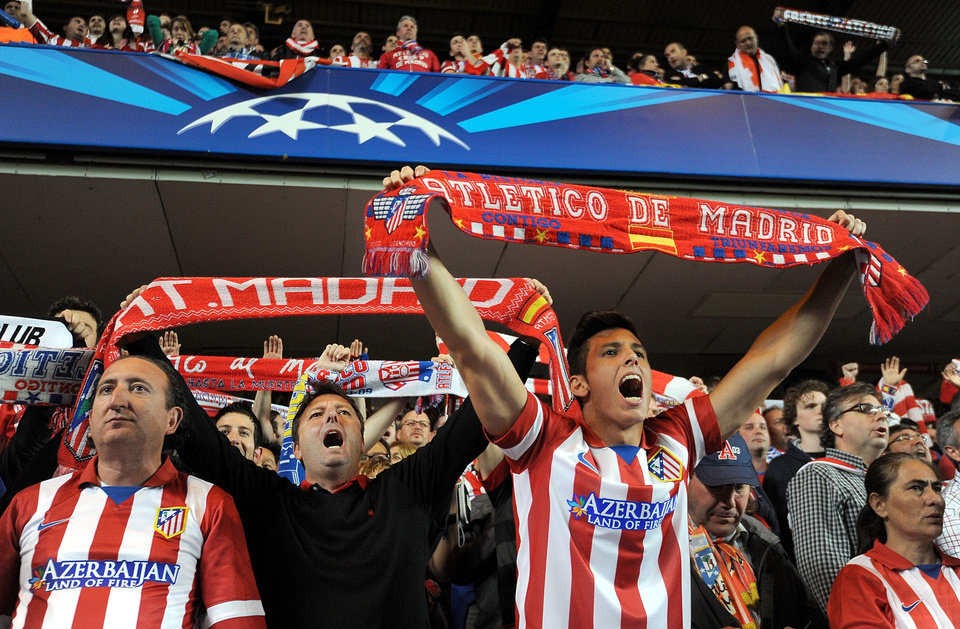 Photo - Atletico Madrid fans show their support in the stands during the Champions League semifinal second leg soccer match between Chelsea and Atletico Madrid at Stamford Bridge Stadium in London, Wednesday, April 30, 2014. (AP Photo/Andrew Matthews, PA Wire)    UNITED KINGDOM OUT   -   NO SALES   -  NO ARCHIVES