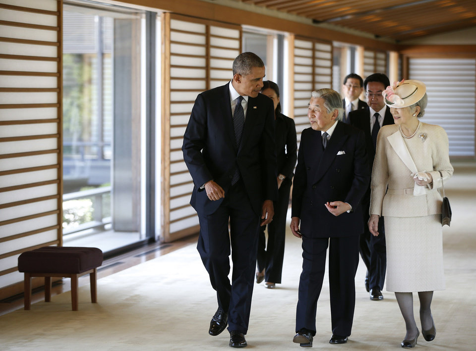 Photo - President Barack Obama walks with with Japanese Emperor Akihito and Empress Michiko after taking part in a welcome ceremony at the Imperial Palace in Tokyo, Thursday, April 24, 2014. Facing fresh questions about his commitment to Asia, President Barack Obama will seek to convince Japan's leaders Thursday that he can deliver on his security and economic pledges, even as the crisis in Ukraine demands U.S. attention and resources elsewhere. The ominous standoff between Ukraine and Russia threatens to overshadow Obama's four-country Asia swing. (AP Photo/Charles Dharapak)