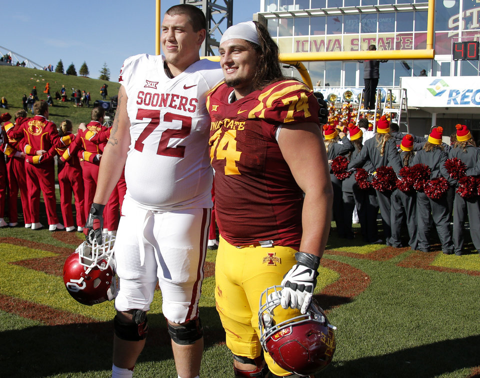 Photo - Oklahoma's Derek Farniok (72) and Iowa State's Tom Farniok (74) pose for a photo after a college football game between the University of Oklahoma Sooners (OU) and the Iowa State Cyclones (ISU) at Jack Trice Stadium in Ames, Iowa, Saturday, Nov. 1, 2014. Photo by Bryan Terry, The Oklahoman