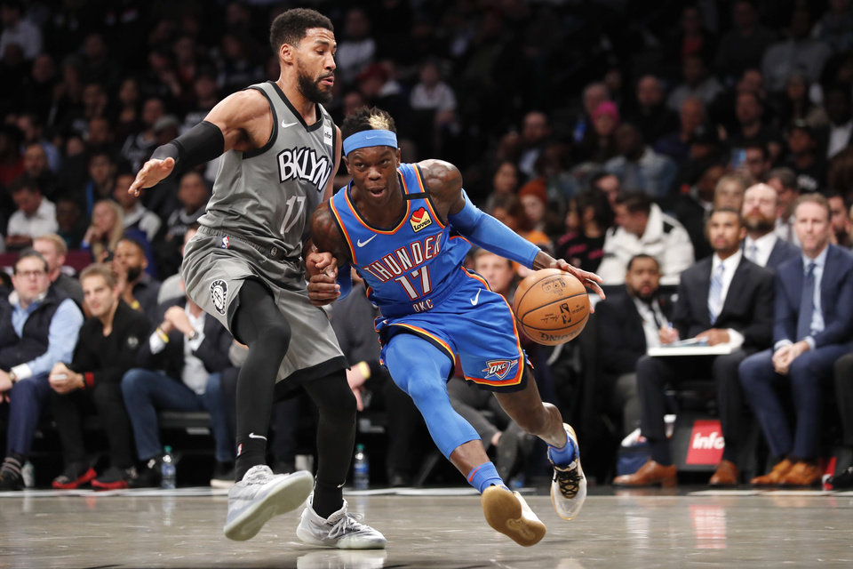 Photo - Oklahoma City Thunder forward Darius Bazley (7) drives up against Brooklyn Nets guard Garrett Temple (17) during the first half of an NBA basketball game, Tuesday, Jan. 7, 2020, in New York. (AP Photo/Kathy Willens)