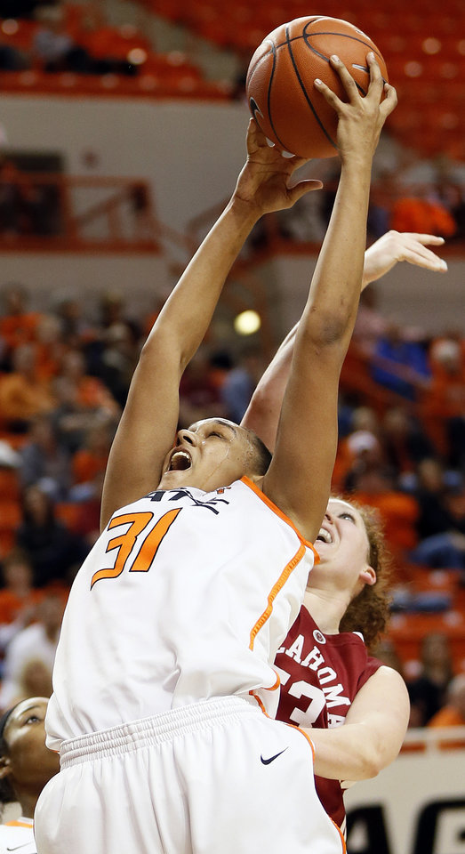 Photo - Oklahoma State's Kendra Suttles (31) grabs a rebound in front of Oklahoma's Joanna McFarland (53) during the Bedlam women's college basketball game between Oklahoma State University (OSU) and the University of Oklahoma (OU) at Gallagher-Iba Arena in Stillwater, Okla., Saturday, Feb. 23, 2013. Photo by Nate Billings, The Oklahoman