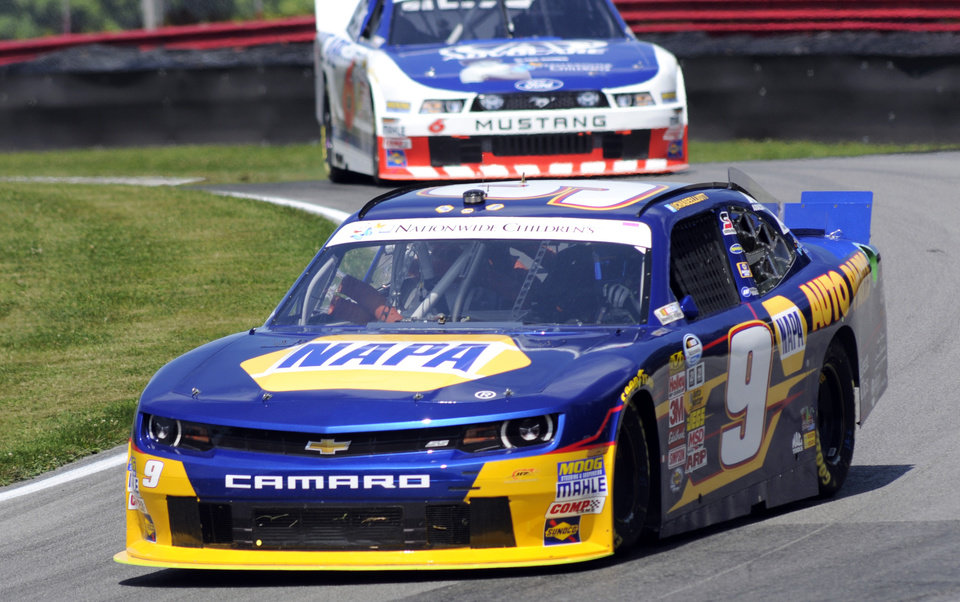 Photo - Chase Elliott drives through a corner during practice for the NASCAR Nationwide Series Nationwide Children's Hospital 200 auto race at Mid-Ohio Sports Car Course Friday, Aug. 15, 2014 in Lexington, Ohio. (AP Photo/Tom E. Puskar)
