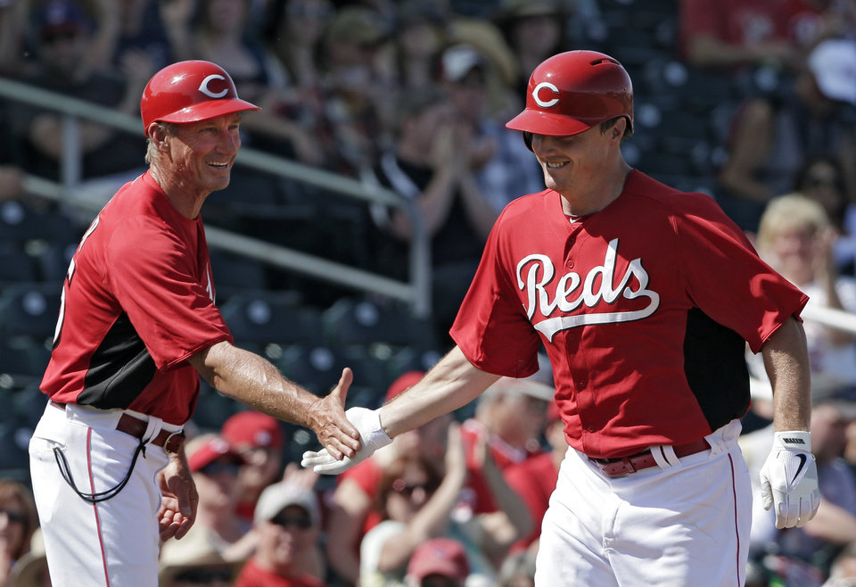 Photo - CORRECTS TO SOLO, INSTEAD OF THREE-RUN, HOME RUN - Cincinnati Reds' Jay Bruce, right, is congratulated by third base coach Mark Berry after Bruce's solo home run against the Chicago White Sox in the fourth inning of a spring training baseball game Tuesday, March 19, 2013, in Goodyear, Ariz. (AP Photo/Mark Duncan)