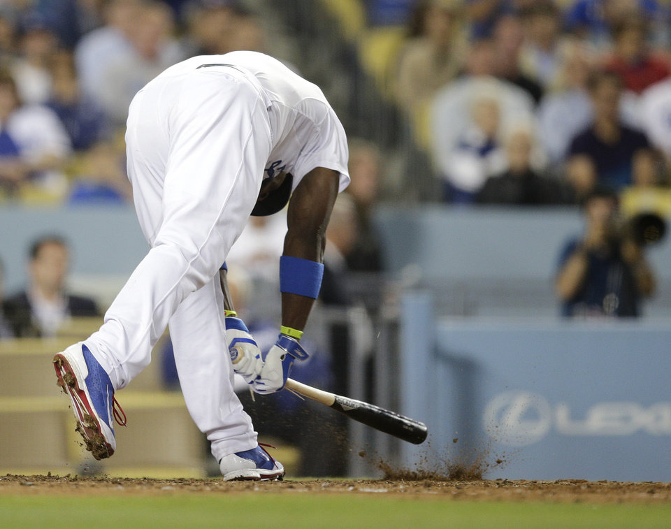Photo - Los Angeles Dodgers' Yasiel Puig slams his bat to the ground after striking out during the sixth inning of a baseball game against the Chicago White Sox on Monday, June 2, 2014, in Los Angeles. (AP Photo/Jae C. Hong)
