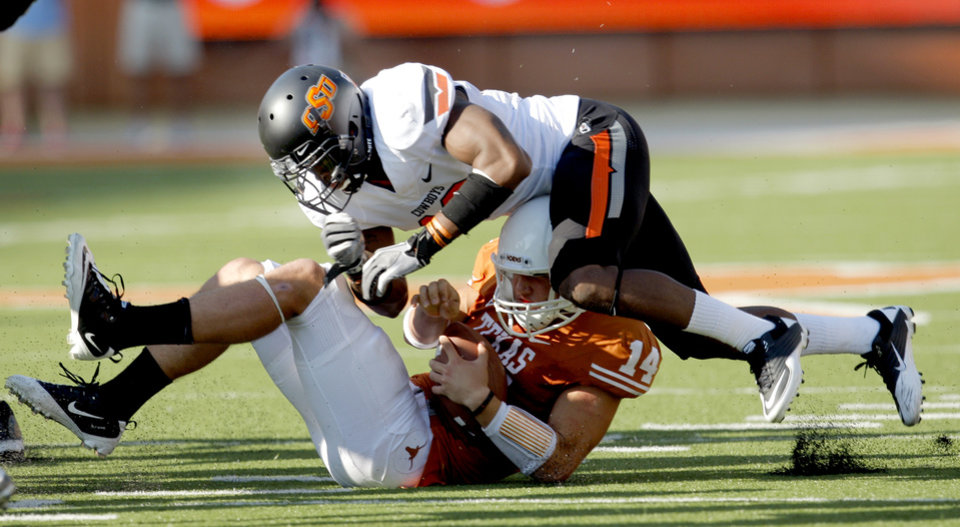 Oklahoma State\'s Markelle Martin (10) tackles Texas\' David Ash (14) during second half of a college football game between the Oklahoma State University Cowboys (OSU) and the University of Texas Longhorns (UT) at Darrell K Royal-Texas Memorial Stadium in Austin, Texas, Saturday, Oct. 15, 2011. Photo by Sarah Phipps, The Oklahoman