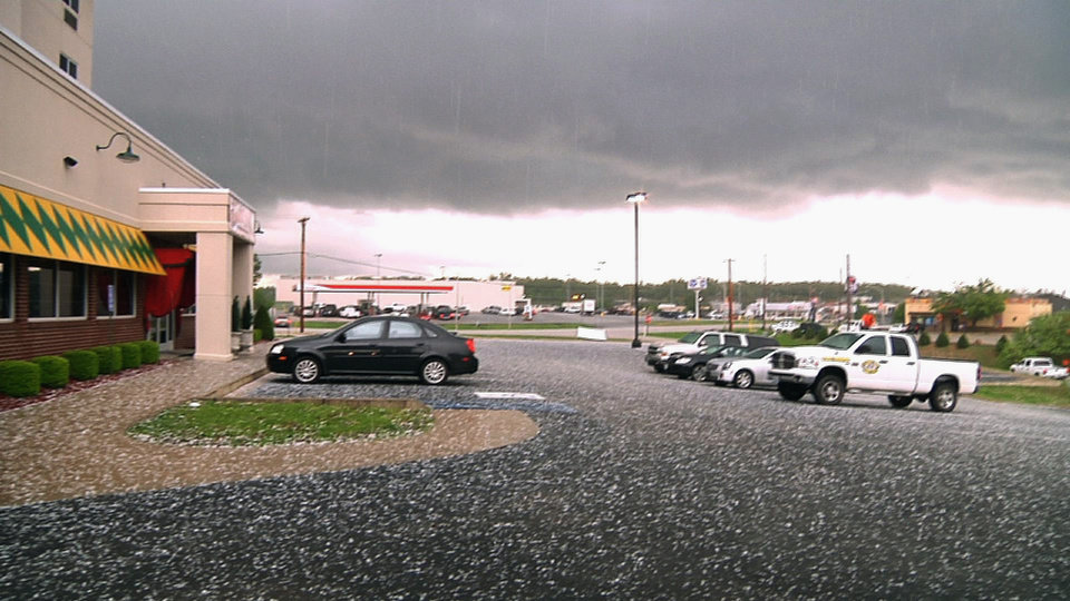 Photo - In this photo taken from video, large hail stones are seen on the ground as a thunderstorm passes through Poplar Bluff, Mo., Wednesday, April 27, 2011. Powerful storms continue to push through the nation's midsection raising river levels to dangerous heights. (AP Photo/Robert Ray)