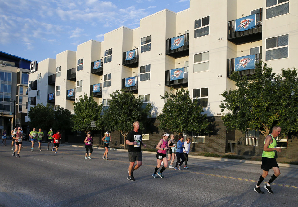 Photo - Runner travel north on Walnut Ave. in Deep Deuce during the Oklahoma City Memorial Marathon in Oklahoma City, Sunday, April 28, 2019. [Nate Billings/The Oklahoman]