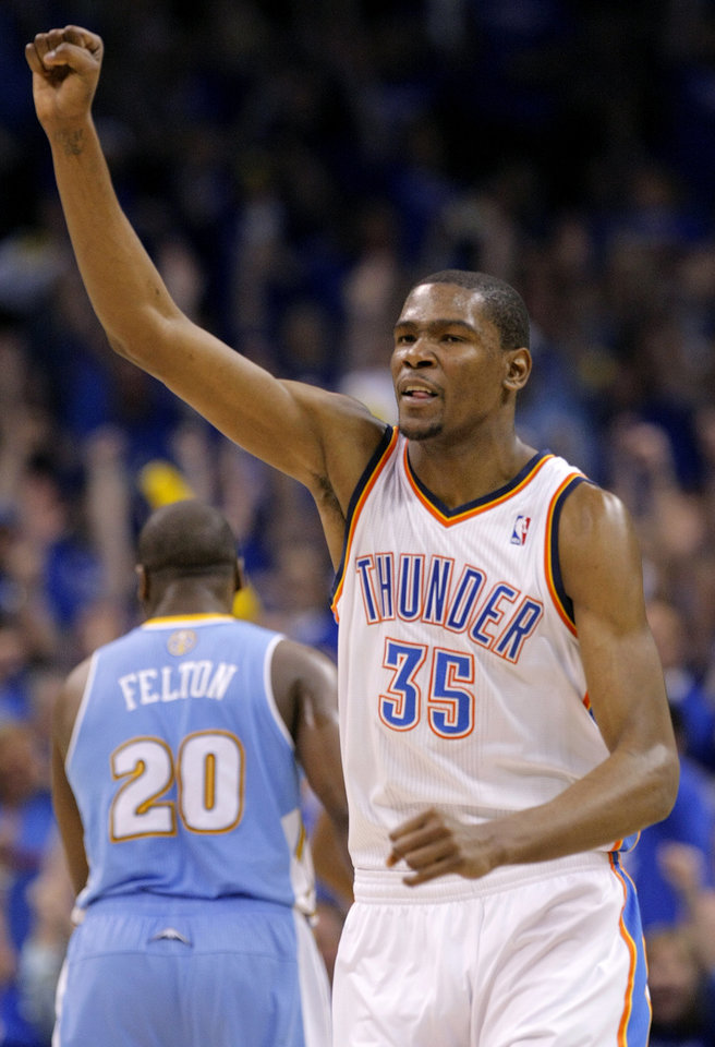 Photo - Oklahoma City's Kevin Durant (35) reacts in the final minutes of the 107-103 win over Denver during the first round NBA playoff game between the Oklahoma City Thunder and the Denver Nuggets on Sunday, April 17, 2011, in Oklahoma City, Okla. Photo by Chris Landsberger, The Oklahoman
