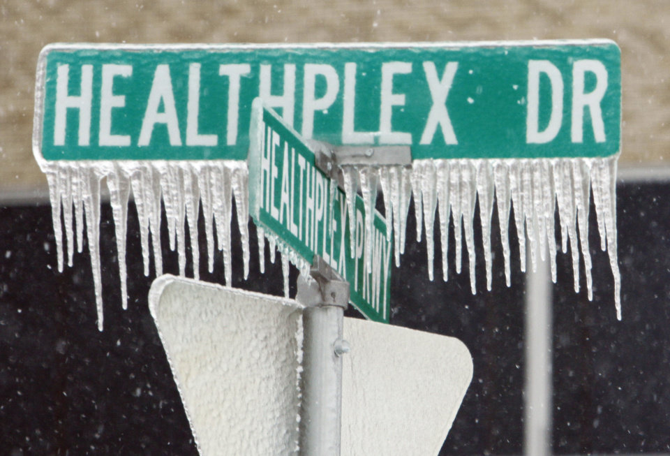 Photo - Ice coats a street sign after Thursday's winter storm on Friday, Jan. 29, 2010, in Norman, Okla.  Photo by Steve Sisney, The Oklahoman