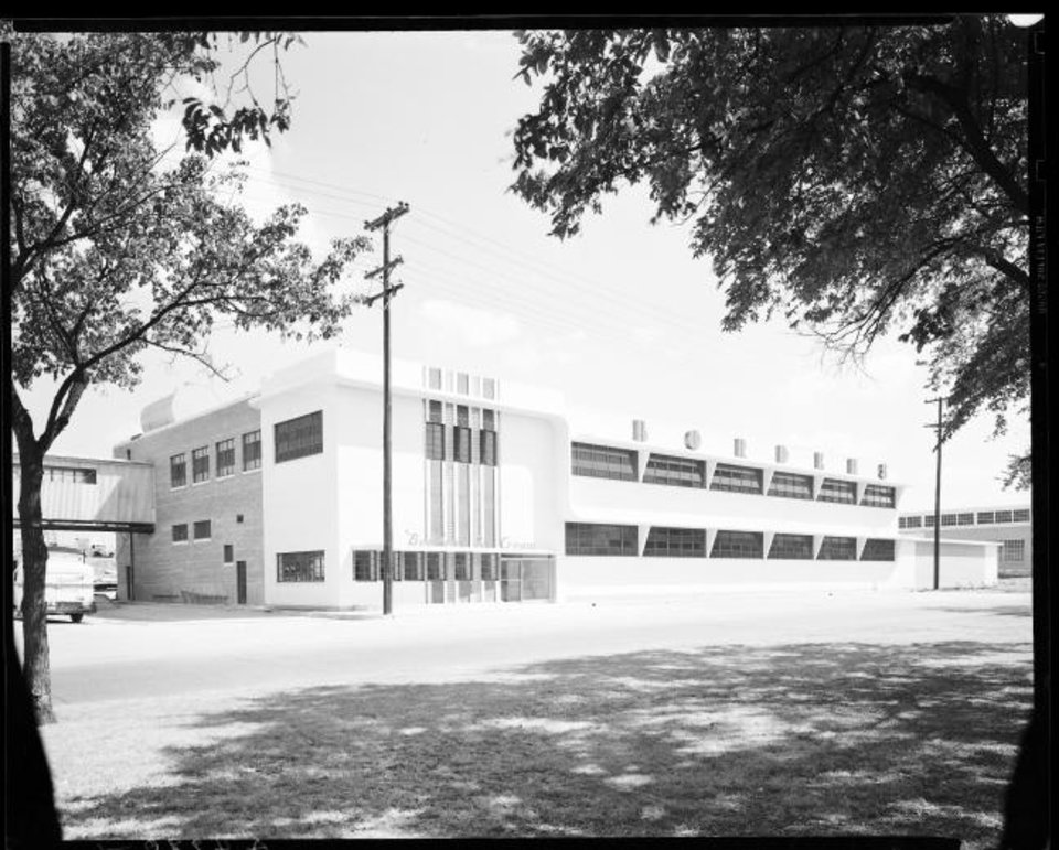 Photo -  The former Borden's Dairy plant at 2124 N Broadway, shown in this 1946 photo shortly before it opened, featured ample windows on both floors looking out on Winans Park. Those windows were later filed in and the building is empty except for Stone SIsters Pizza Bar which is in the former Borden's ice cream parlor in lower north corner of the building. Photo courtesy of the Oklahoma Historical Society.