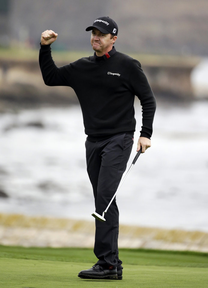 Photo - Jimmy Walker celebrates on the 18th green Sunday, Feb. 9, 2014, after winning the AT&T Pebble Beach Pro-Am golf tournament in Pebble Beach, Calif. (AP Photo/Eric Risberg)