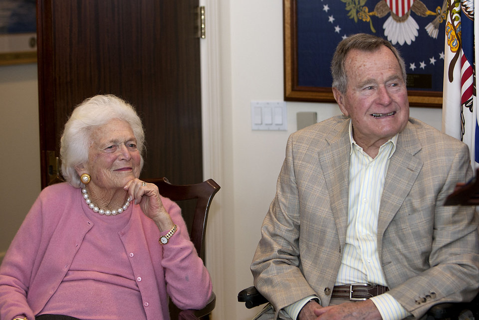 Photo - In this Dec. 23, 2013 photo, former first Lady Barbara Bush left, and former President George H. W. Bush look on during a ceremony  at President Bush's office in Houston.  Former first lady Barbara Bush has been hospitalized in Houston with a respiratory-related issue, Tuesday, Dec. 31, 2013. A statement Tuesday night from the office of her husband, former President George H.W. Bush, said she was admitted to Houston Methodist Hospital on Monday. (AP Photo/Houston Chronicle, James Nielsen)  MANDATORY CREDIT; MAGS OUT