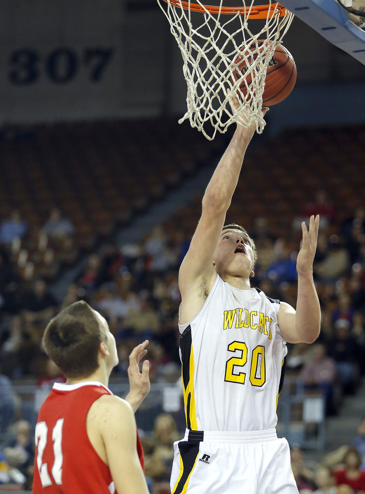 Photo - Arnett's Tyler Tune shoots over Big Pasture's Cameron Smith during the Class B Boys semifinal game of the state high school basketball tournament between Big Pasture and Arnett at the State Fair Arena., Friday, March 1, 2013. Photo by Sarah Phipps, The Oklahoman