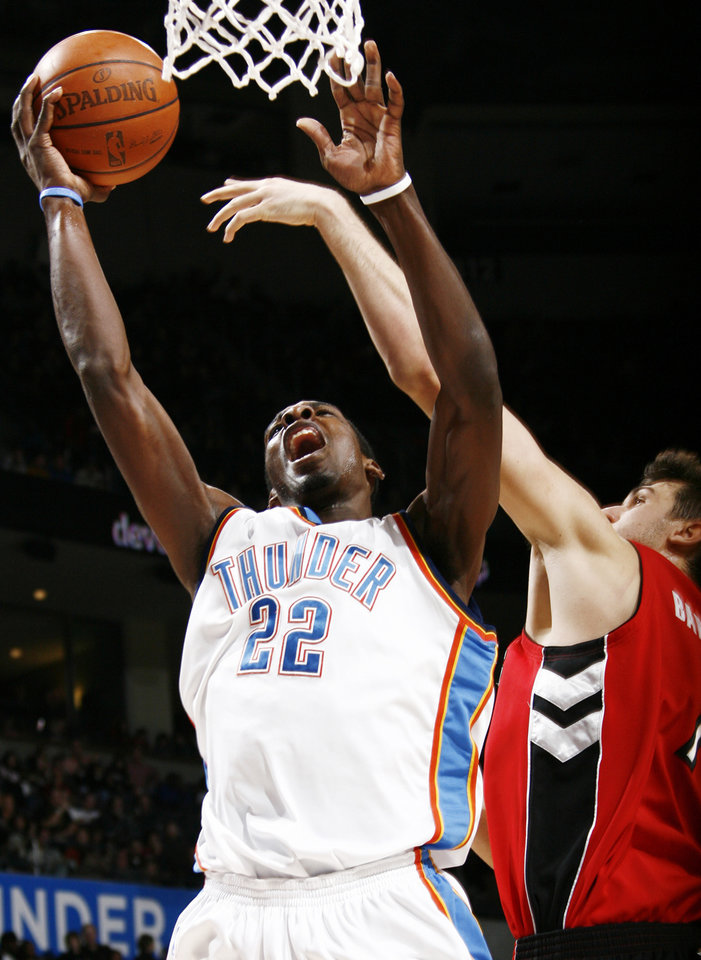 Oklahoma City's Jeff Green is fouled by Andrea Bargnani of Toronto in the second half of the NBA basketball game between the Toronto Raptors and the Oklahoma City Thunder at the Ford Center in Oklahoma City, Friday, Dec. 19, 2008. The Thunder won, 91-83. BY NATE BILLINGS, THE OKLAHOMAN