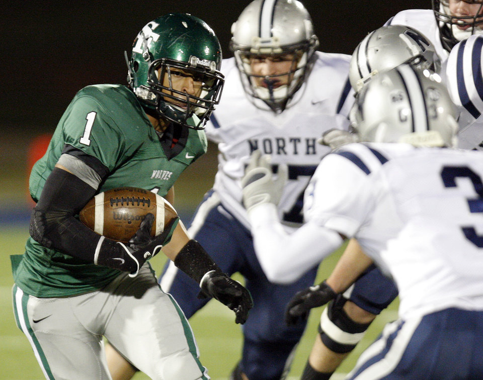 Photo - Phillip Sumpter (1) of Edmond Santa Fe carries the ball during a high school football game between Edmond Santa Fe and Edmond North at Wantland Stadium in Edmond, Okla., Friday, Oct. 28, 2011. Photo by Nate Billings, The Oklahoman