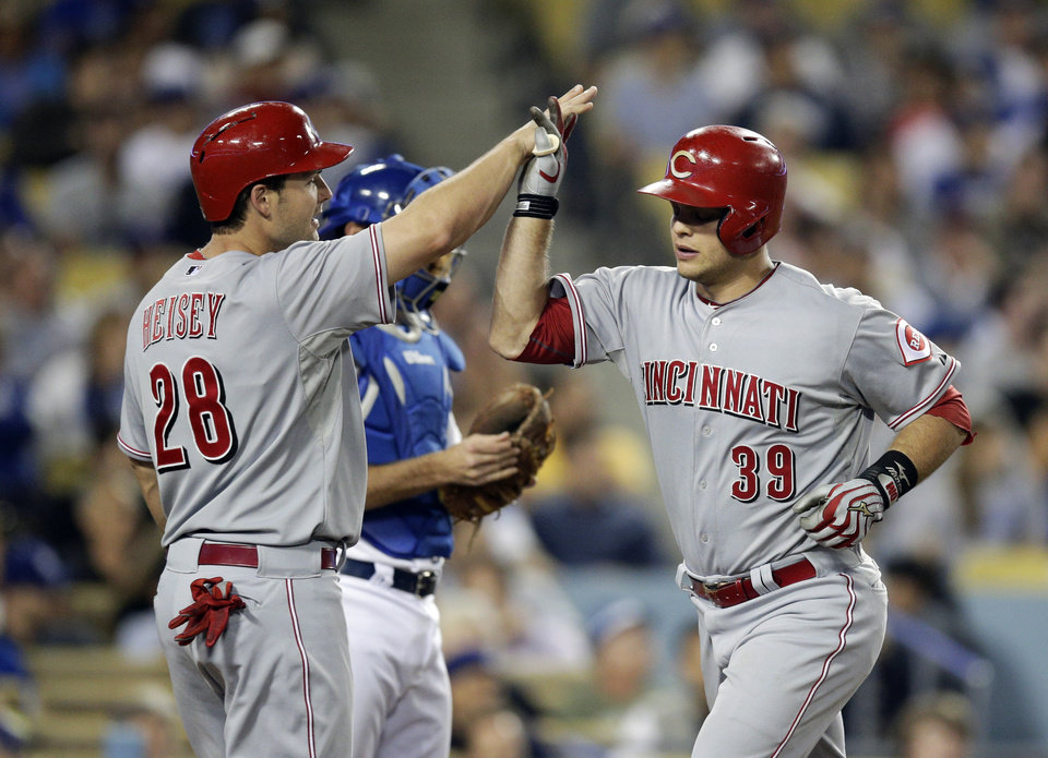 Photo - Cincinnati Reds' Devin Mesoraco, right, celebrates his two-run home run with Chris Heisey during the eighth inning of a baseball game against the Los Angeles Dodgers on Tuesday, May 27, 2014, in Los Angeles. (AP Photo/Jae C. Hong)