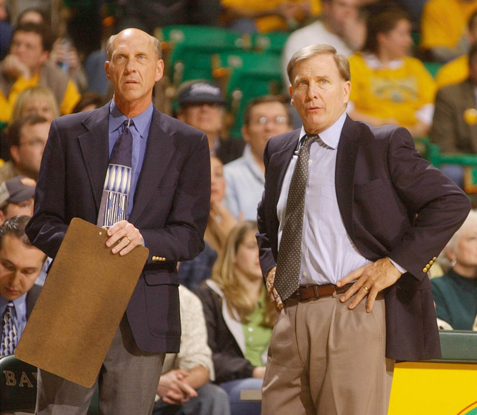 Photo - ** ADVANCE FOR WEEKEND, FEB. 8-9-FILE ** Baylor University head college basketball coach Dave Bliss, right, and longtime assistant Doug Ash watch from the bench during their game with Oklahoma Sat. Jan 25, 2003 in Waco, Texas. Bliss and Ash have been coaching together 28 seasons, college basketball's longest-serving coaching duo. (AP Phoot/Rod Aydelotte)