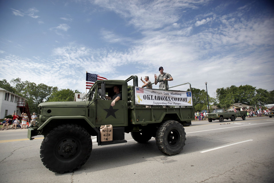 Photo - A float drives by during the LibertyFest Parade in Edmond, Okla., Monday, July 4, 2011. Photo by Sarah Phipps, The Oklahoman