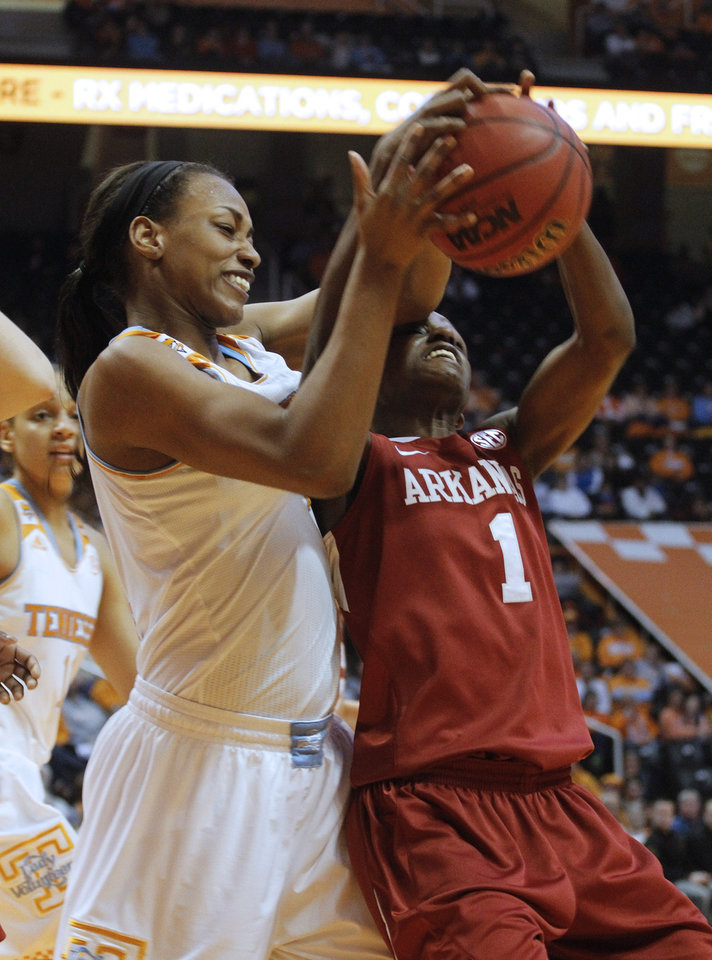 Photo - Arkansas' Keira Peak, right, rebounds the ball against Tennessee's Bashaara Graves, left, in the first half of an NCAA college basketball game, Thursday, Jan. 30, 2014, in Knoxville, Tenn. (AP Photo/Lisa Norman-Hudson)