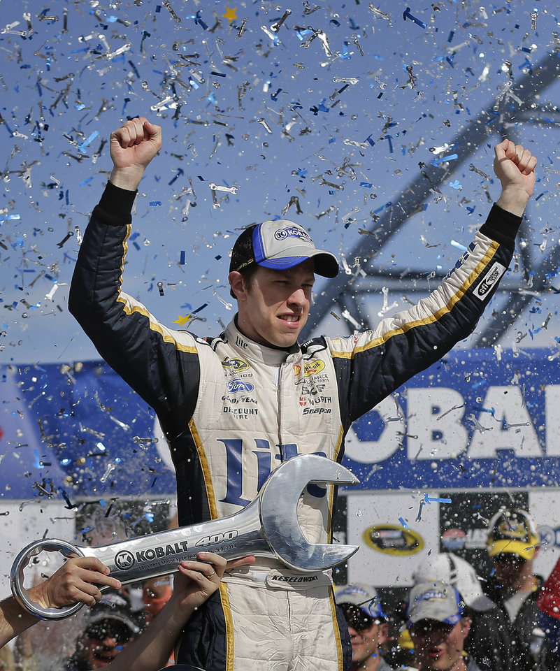 Photo - Brad Keselowski celebrates after winning a NASCAR Sprint Cup Series auto race on Sunday, March 9, 2014, in Las Vegas. Keselowski overtook Dale Earnhardt Jr. on the last lap when Earnhardt ran out of fuel. (AP Photo/Julie Jacobson)