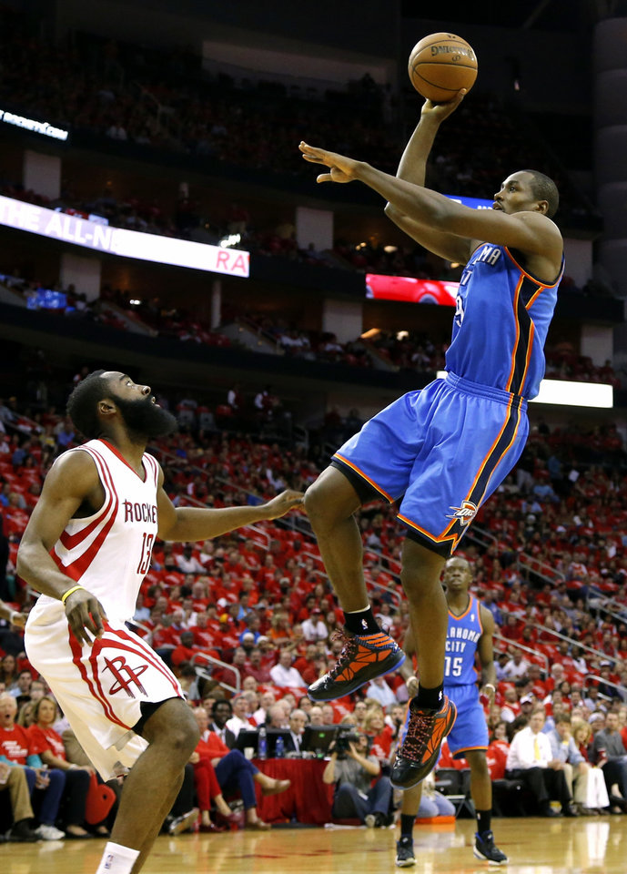 Photo - Oklahoma City's Serge Ibaka shoots over Houstons's James Harden during Game 4 in the first round of the NBA playoffs between the Oklahoma City Thunder and the Houston Rockets at the Toyota Center in Houston, Texas, Monday, April 29, 2013. Photo by Bryan Terry, The Oklahoman