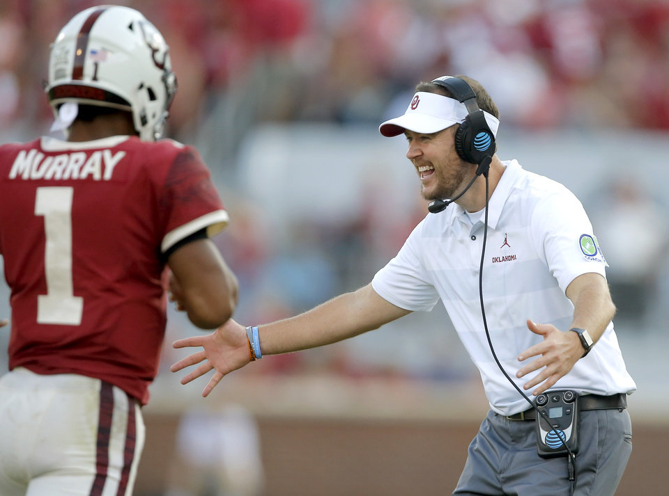 Photo - Oklahoma coach Lincoln Riley greets Kyler Murray after a touchdown during a college football game between the University of Oklahoma Sooners (OU) and the Baylor Bears at Gaylord Family-Oklahoma Memorial Stadium in Norman, Okla., Saturday, Sept. 29, 2018. Oklahoma won 66-33.  Photo by Bryan Terry, The Oklahoman