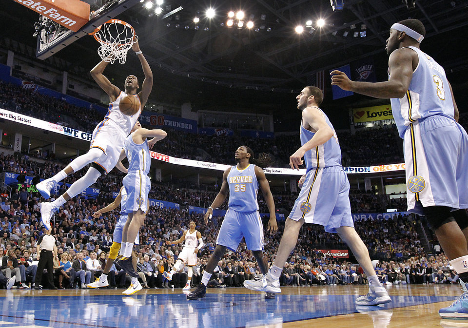 Oklahoma City's Kevin Durant (35) dunks the ball over Denver's Danilo Gallinari (8) during the NBA basketball game between the Oklahoma City Thunder and the Denver Nuggets at the Chesapeake Energy Arena on Wednesday, Jan. 16, 2013, in Oklahoma City, Okla.  Photo by Chris Landsberger, The Oklahoman
