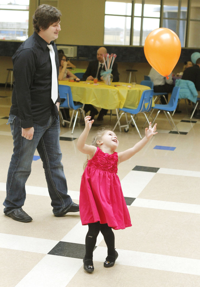 Three year old Jocelyn Martin and her father Thad play with a balloon during the Deer Creek Daddy daughter dance at Deer Creek High School in Oklahoma City, OK, Saturday, January 26, 2013,  By Paul Hellstern, The Oklahoman