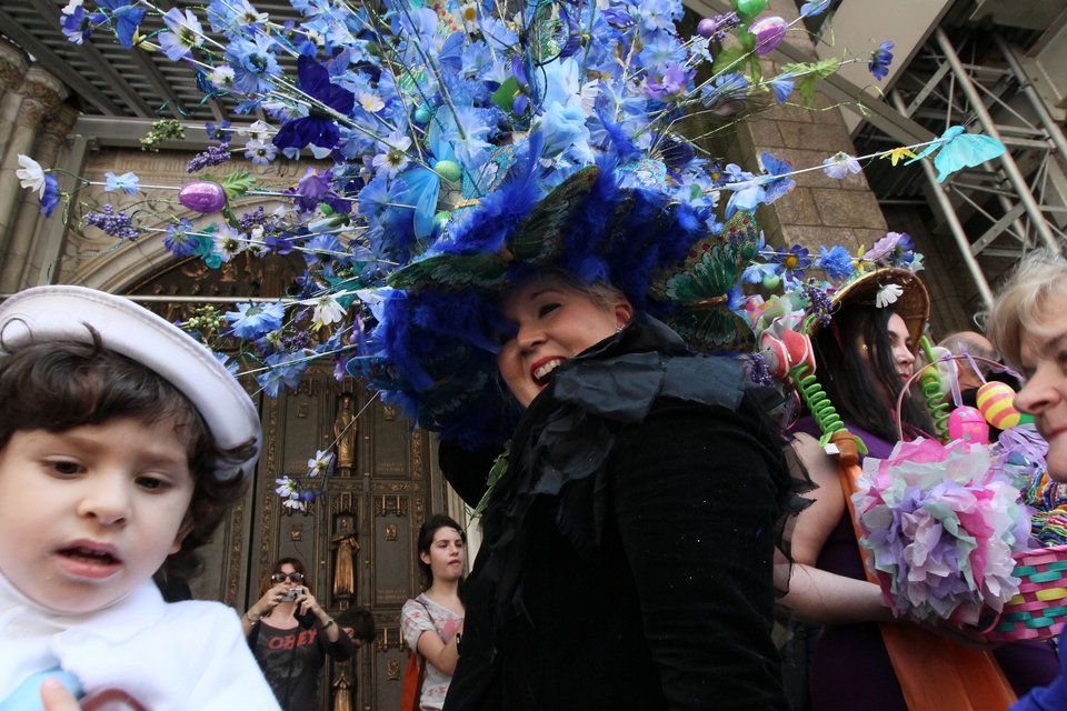 Photo -   Vanessa Sterbenz-Guerra, of the Queens borough of New York, foreground wearing black, smiles as she poses for photographs with a flowery hat atop her head as she and others take part in the Easter Parade along New York's Fifth Avenue Sunday April 24, 2011. (AP Photo/Tina Fineberg)