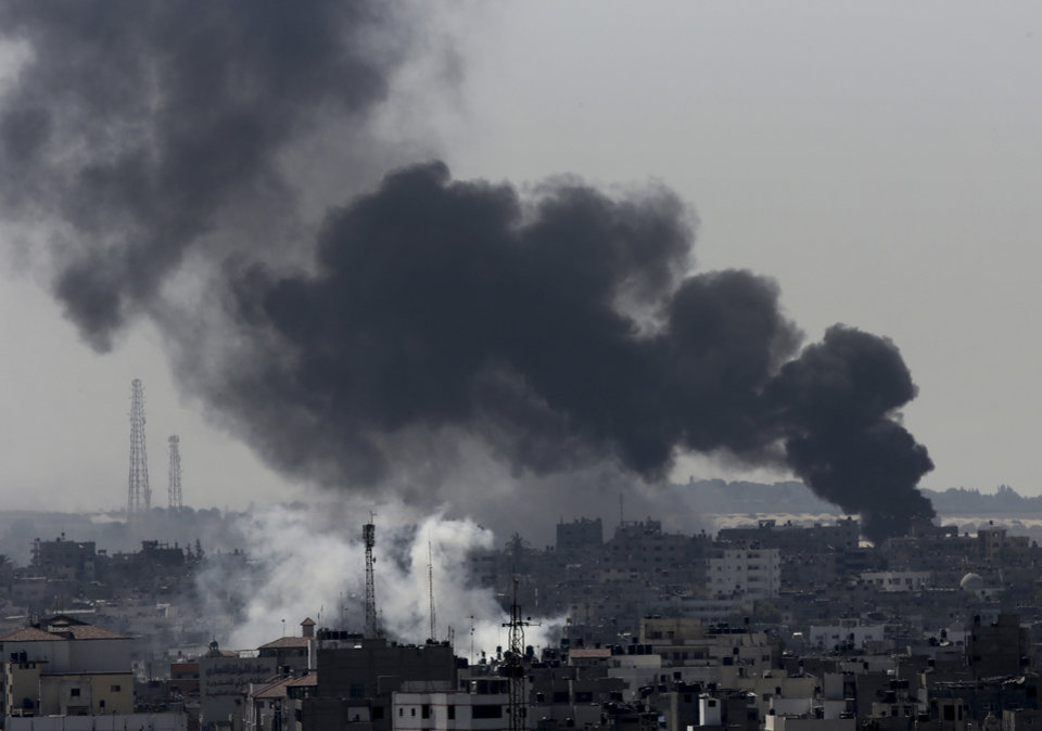 Photo - Smoke from Israeli strikes rises over Gaza City, in the northern Gaza Strip, Sunday, July 27, 2014. Israel resumed its Gaza offensive on Sunday, calling off a unilateral extension of a humanitarian cease-fire after Palestinian militants fired several rockets at southern Israel. The rocket fire began late Saturday after Gaza's Hamas rulers, who have demanded the lifting of an Israeli and Egyptian blockade on the territory and the release of prisoners, refused to extend the truce. (AP Photo/Adel Hana)