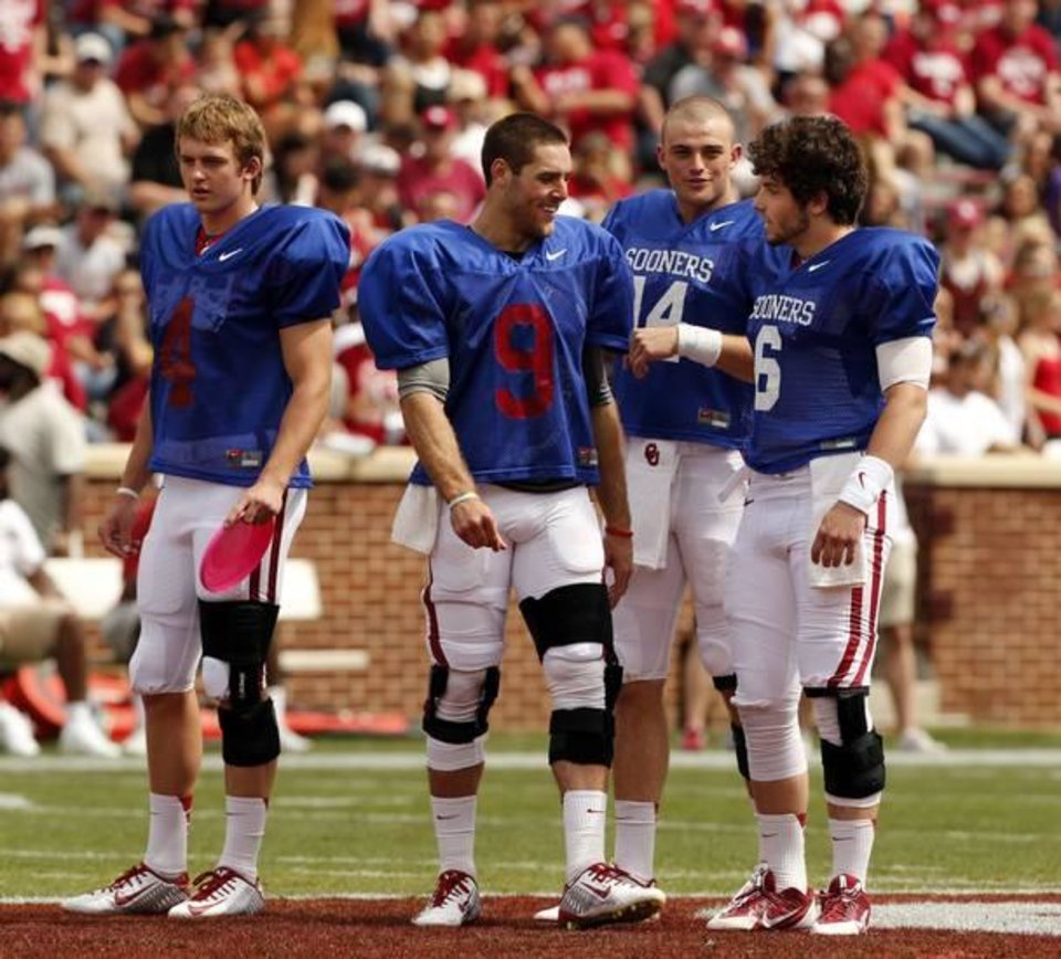 Photo -  Quarterbacks (from left) Justice Hansen, Trevor Knight, Cody Thomas and Baker Mayfield stand at midfield before the 2014 OU spring game. (Photo by Steve Sisney)