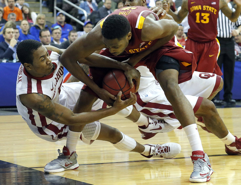 Photo - Oklahoma's Je'lon Hornbeak (5) and Melvin Ejim (3) fight for a loose ball during the Phillips 66 Big 12 Men's basketball championship tournament game between the University of Oklahoma and Iowa State at the Sprint Center in Kansas City, Thursday, March 14, 2013. Photo by Sarah Phipps, The Oklahoman