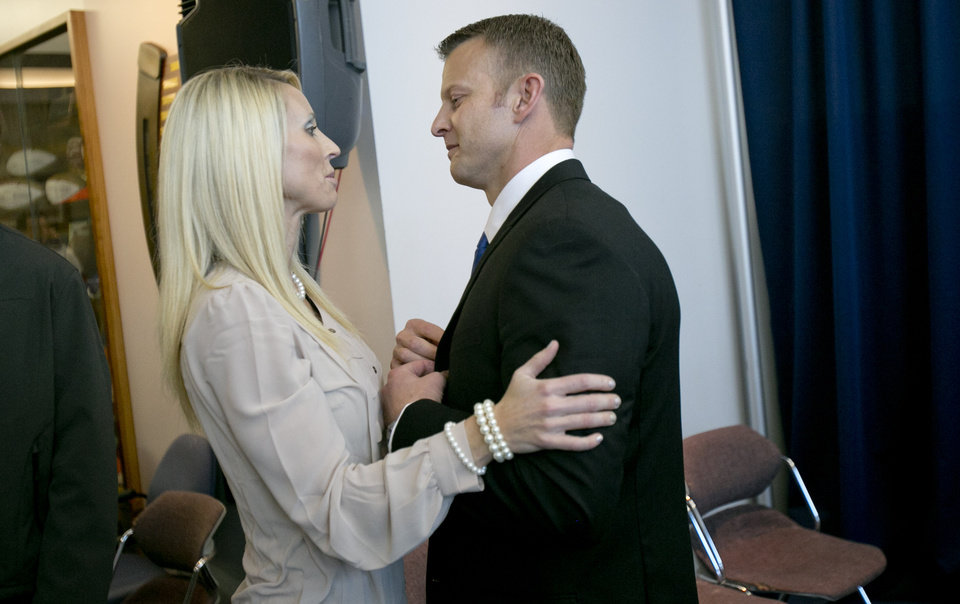Photo - Boise State's new head coach Bryan Harsin is greeted by his wife, Kes Harsin after he was introduced at an NCAA college football news Conference Friday, Dec. 13, 2013, in Boise, Idaho. (AP Photo/The Idaho Statesman, Kyle Green) MANDITORY CREDIT; LOCAL TV OUT