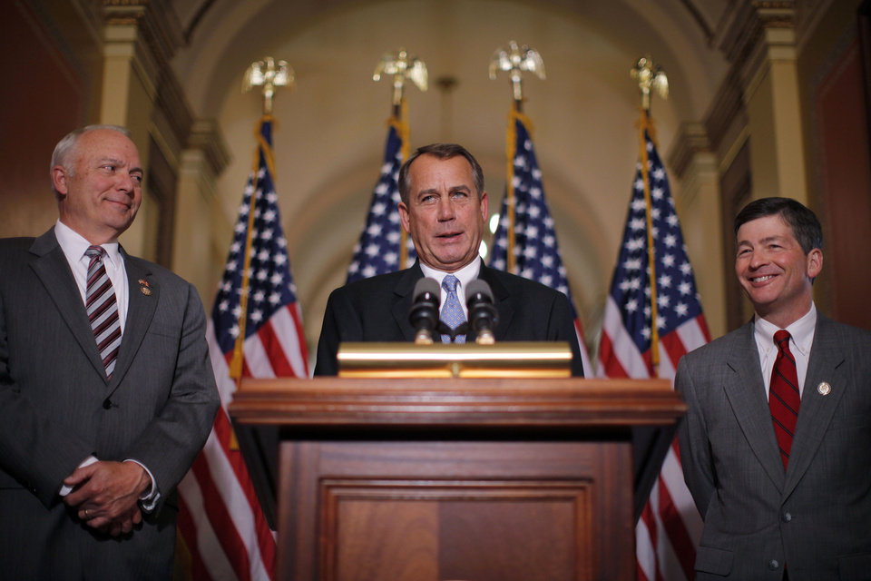 Photo -   House Speaker John Boehner of Ohio, accompanied by House Education and the Workforce Committee Chairman Rep. John Kline, R-Minn., left, and Rep. Jeb Hensarling, R-Texas, speak about a student loans bill, Wednesday, April 25, 2012, on Capitol Hill in Washington. (AP Photo/Charles Dharapak)