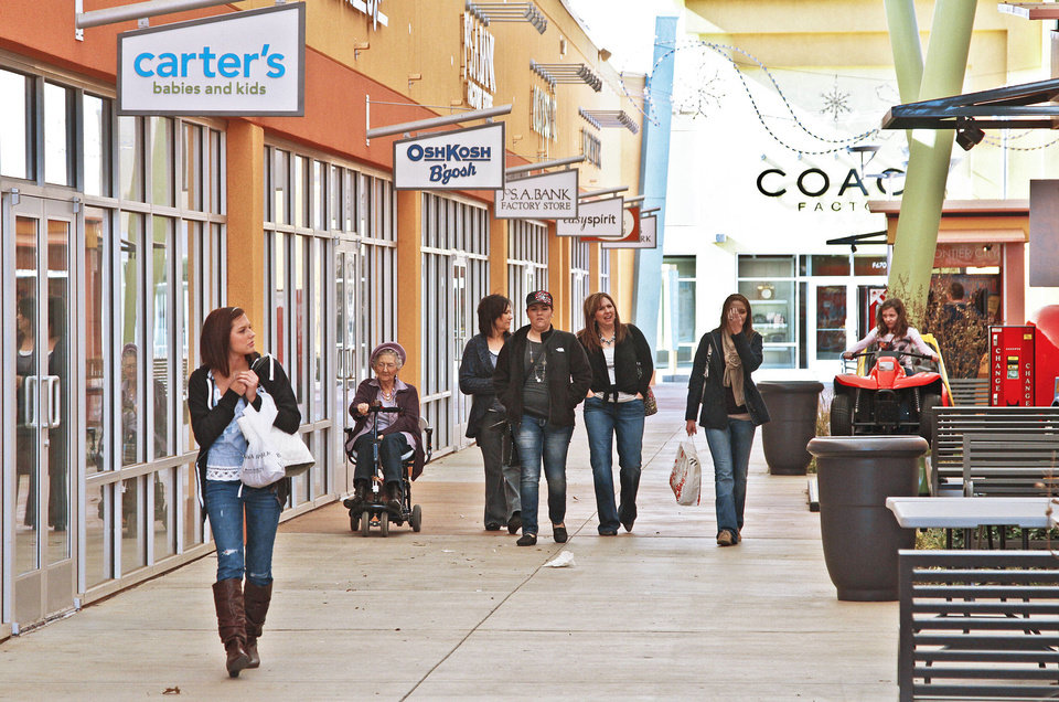 Shoppers walk inside The Outlet Shoppes at Oklahoma City, 7624 W Reno Ave., on Jan. 3.  Photo by Chris Landsberger, The Oklahoman Archives