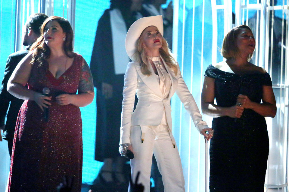 """Photo - Mary Lambert, from left, Madonna, and Queen Latifah appear on stage during a performance of """"Same Love"""" at the 56th annual Grammy Awards at Staples Center on Sunday, Jan. 26, 2014, in Los Angeles. (Photo by Matt Sayles/Invision/AP)"""