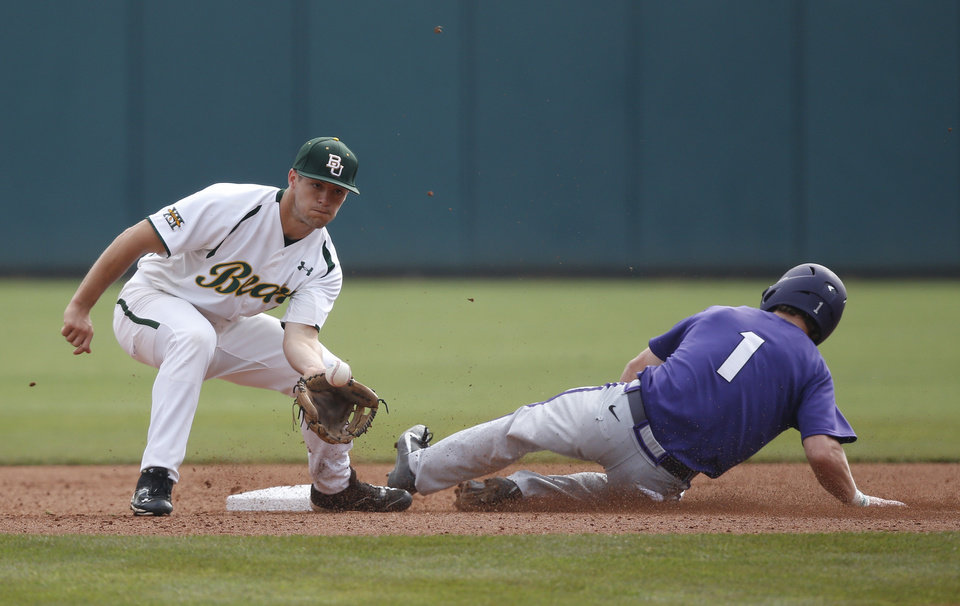 Photo - Baylor shortstop Brent Doe, left, takes the throw as TCU's Cody Jones (1) safely steals second base in the first inning of a game during the Big 12 conference NCAA college baseball tournament in Oklahoma City, Saturday, May 24, 2014. (AP Photo/Sue Ogrocki)
