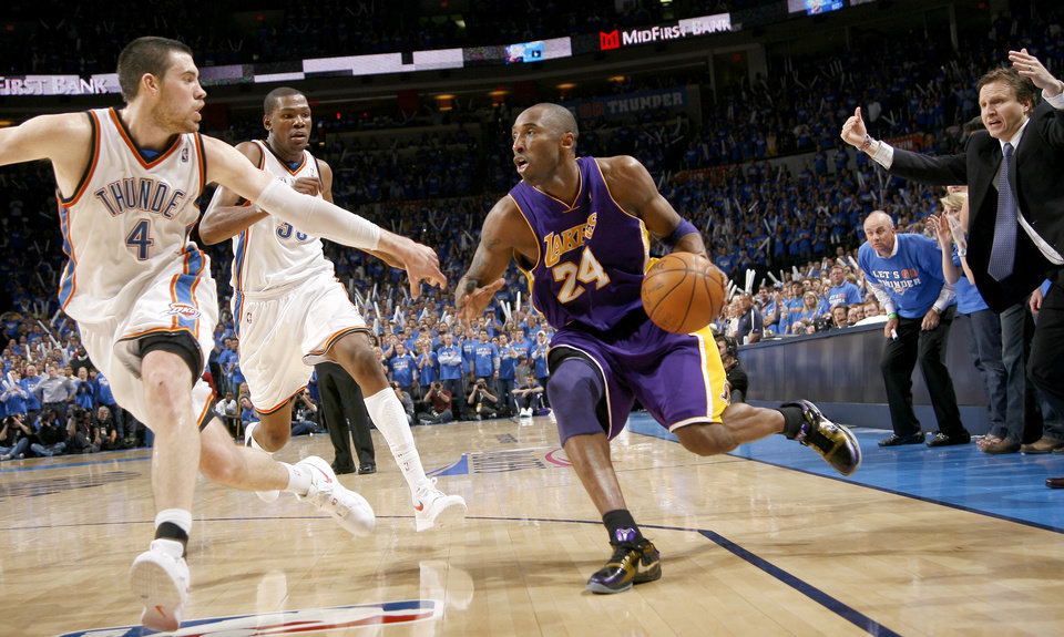 Photo - L.A.'s Kobe Bryant drives past Oklahoma City's Nick Collison, left, and Kevin Durant during the NBA basketball game between the Los Angeles Lakers and the Oklahoma City Thunder in game six of the first round series at the Ford Center in Oklahoma City, Friday, April 30, 2010. [Bryan Terry/The Oklahoman]