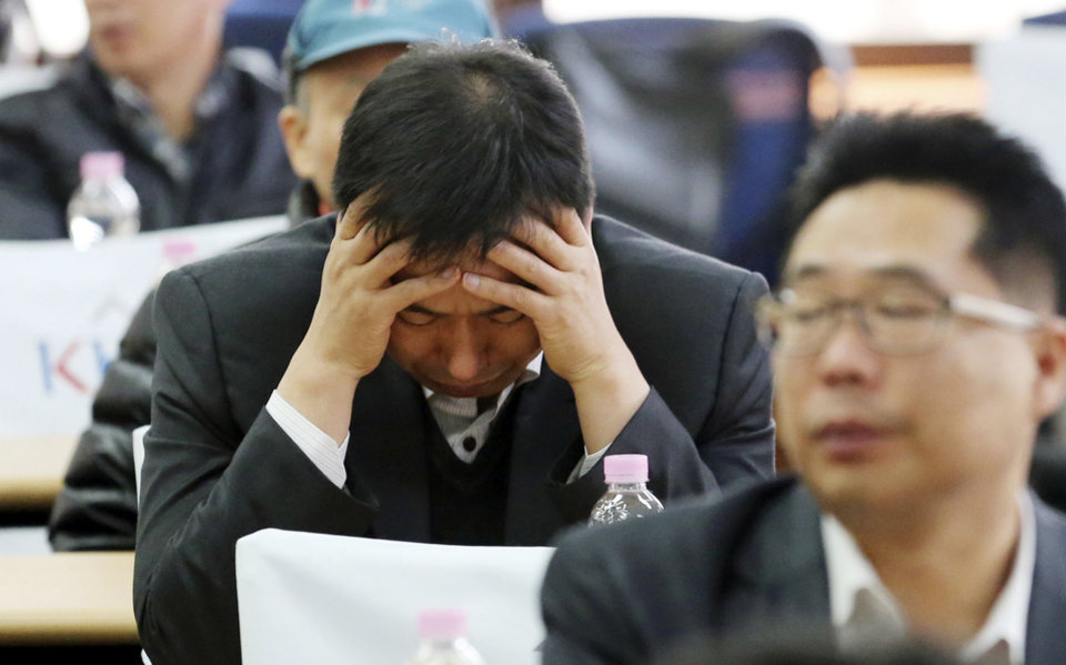 Photo - A South Korean businessman reacts during an emergency meeting of the Corporate Association of Kaesong Industrial Complex in Seoul, South Korea, Tuesday, April 9, 2013. The factory complex that is North Korea's last major economic link with the South was a virtual ghost town Tuesday after Pyongyang suspended its operations and recalled all 53,000 of its workers, cutting off jobs and a source of hard currency in its war of words and provocations against Seoul and Washington. (AP Photo/Choi Jae-goo, Yonhap) KOREA OUT