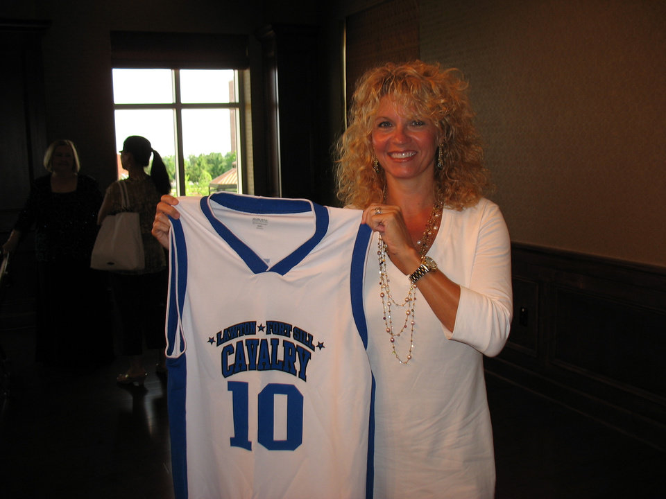 OU women's basketball coach Sherri Coale was presented with a Lawton/Fort Sill Cavalry jersey on Friday. (PHOTO PROVIDED)