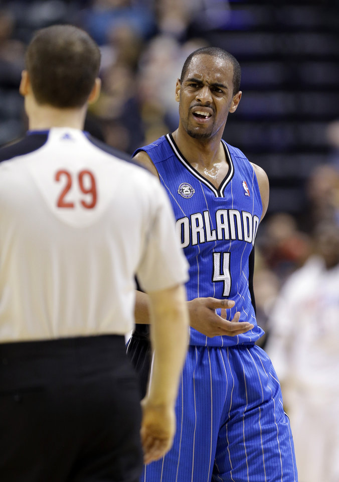 Photo - Orlando Magic guard Arron Afflalo continues to question referee Mark Lindsay after he was charged with a technical foul in the second half of an NBA basketball game against the Indiana Pacers  in Indianapolis, Monday, Feb. 3, 2014. The Pacers defeated the Magic 98-79. (AP Photo/Michael Conroy)