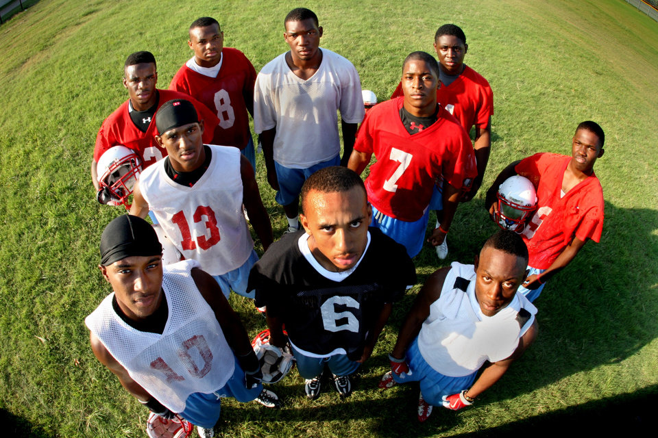 Photo - ORG XMIT: *S0427286247* (08/13/09) --- Skyline High School football players who have orally committed to NCAA Division 1-A schools before the season has even started.  Front row, left to right, Mike Davis, Javia Hall, Tony Drake.  Back row, left to right, Domonique Patterson (holding helmet), Joe Powell (13), Rodney Williams (8), Graylin Hawkins, Corey Nelson (7), DeMarcus Shaw and Adrian James.  Photographed during football practice at Skyline Thursday August 13, 2009.  (Courtney Perry/Staff Photographer)  ***Note: Jerseys are practice jerseys only, not real numbers.  ALSO: DeMarcus Shaw has been invited to play for a school(s) but has not yet committed to one.  He got into this photo by accident. ORG XMIT: DMN4127662