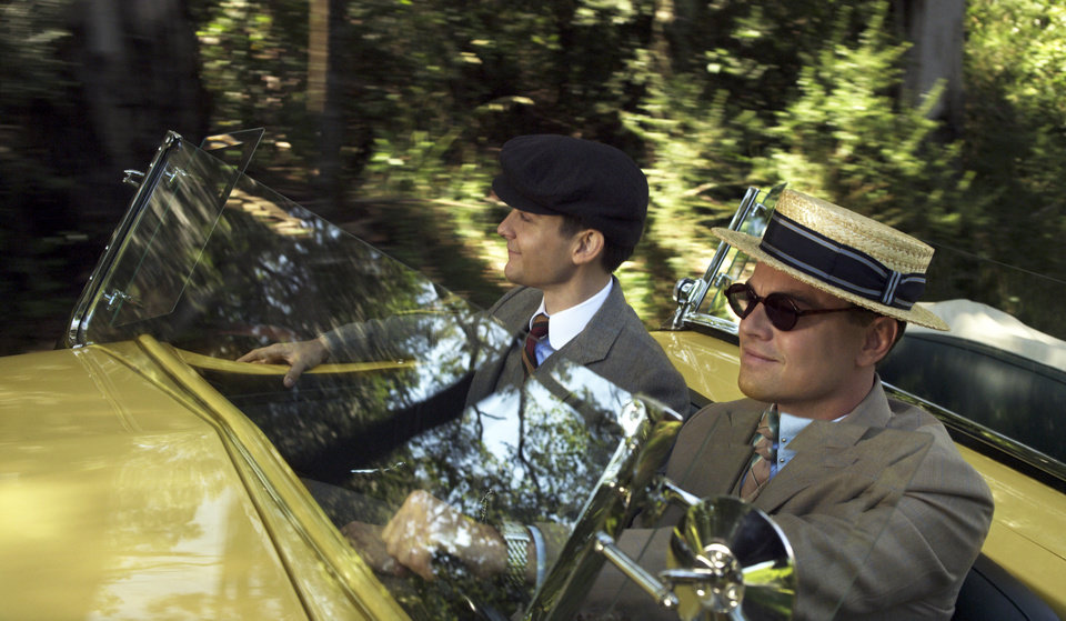 This film publicity image released by Warner Bros. Pictures shows Tobey Maguire as Nick Carraway and Leonardo DiCaprio as Jay Gatsby in a scene from